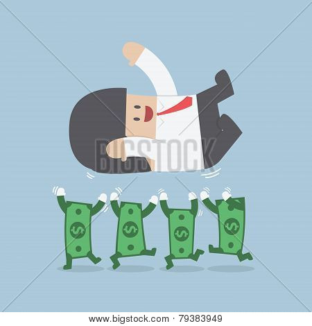 Successful Businessman Being Throwing Up By Dollar Bill