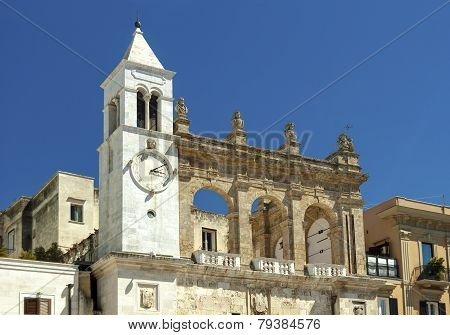 house with a bell tower and clock