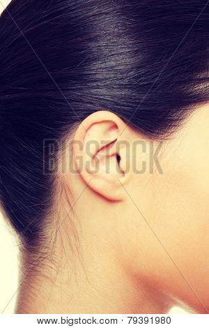 Young caucasian woman ear closeup.