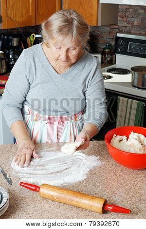 Senior Woman Making Pie