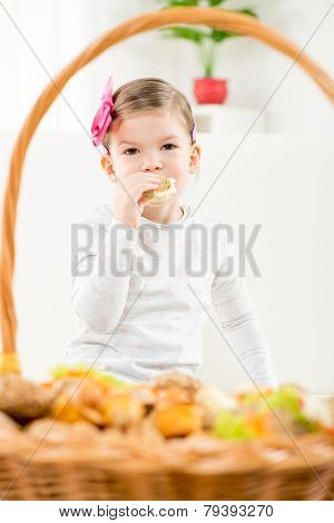A Little Girl Eating Pastry