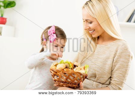 Cute Mom And Daughter With Pastries