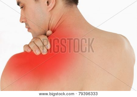 Young male with neck pain against a white background