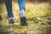 foto of legs feet  - feet in shoes on a forest path - JPG