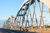 stock photo of arch foot  - Metal arch bridge for cars and trains - JPG