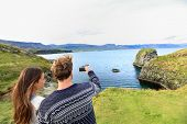 picture of yoke  - Tourists on travel taking photo with smartphone on Iceland - JPG