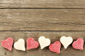 picture of bottom  - Heart shaped Valentines Day candy bottom border on a wooden background - JPG