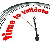 stock photo of confirmation  - Time to Validate words on a clock face to illustrate the need to qualify - JPG