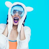 foto of swag  - Screaming crazy girl in hoodie Teddy Bear on a blue background - JPG