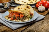 picture of indian  - Indian naan with meatballs and tomato sauce spicy sauce and exotic indian naan bread - JPG