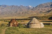 image of yurt  - Nomadic settlements with yurts on green grasslands in Kyrgyzstan - JPG