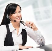 image of electronic cigarette  - Young and attractive business woman with an electronic cigarette working in office isolated on white - JPG