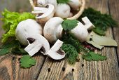 picture of crimini mushroom  - Champignon mushrooms in basketherbs and spices on a wooden background - JPG