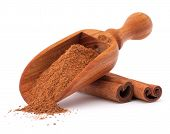 stock photo of cinnamon  - ground cinnamon spice powder in wooden spoon isolated on white background cutout - JPG