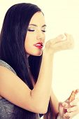 pic of perfume  - Beautiful woman applying perfume on her body - JPG