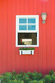stock photo of red siding  - Red front door of an upscale home - JPG
