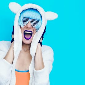 picture of hoodie  - Screaming crazy girl in hoodie Teddy Bear on a blue background - JPG