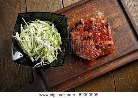 Delicious steak with red chili pepper