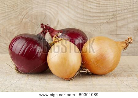 Onions And Red Onions On Wooden Background