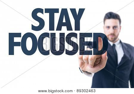Business man pointing the text: Stay Focused