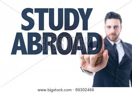 Business man pointing the text: Study Abroad