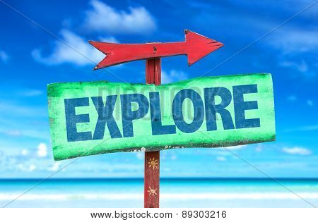 Explore sign with beach background