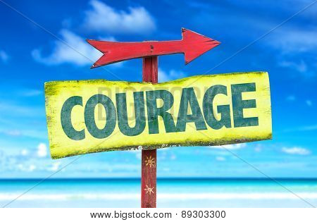 Courage sign with beach background