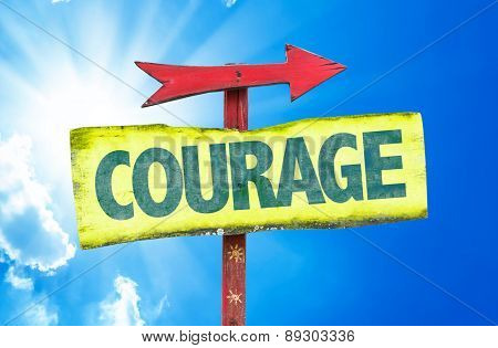 Courage sign with sky background