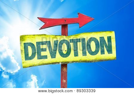 Devotion sign with sky background