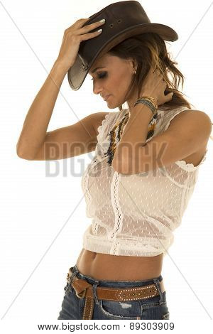 Cowgirl In White Top With Hat Side Look Down