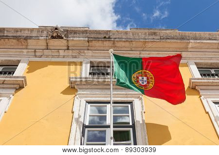 Portugal Flag Waving On The Wind In Front An Administrative Building