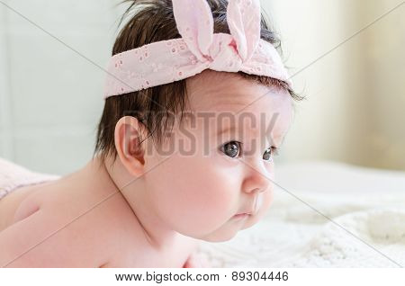 Portrait Of Beautiful Sweet Newborn Baby Girl Side-face