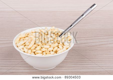Small White Glass Bowl With Puffed Rice And Teaspoon