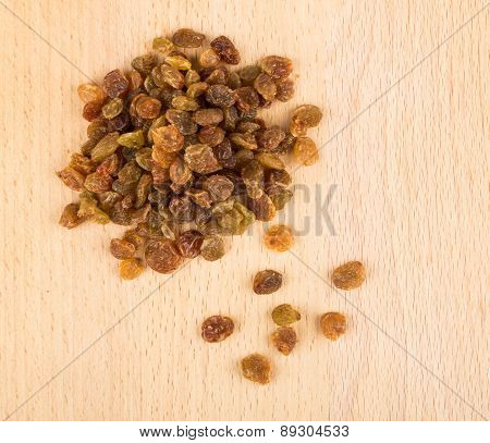 Heap Of Dried Grapes On Wooden Board