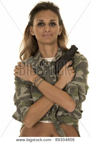 Woman Camo Shirt Belly Showing Gun Arms Across Chest