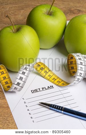 Diet Concept - Paper With Diet Plan, Apples And Measure Tape On Table