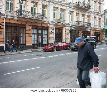 Ukraine, Kiev - September 9, 2013: Expensive Supercars And Poor Side By Side On The Streets
