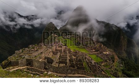 The Ruins Of Machu Picchu On A Foggy Ay