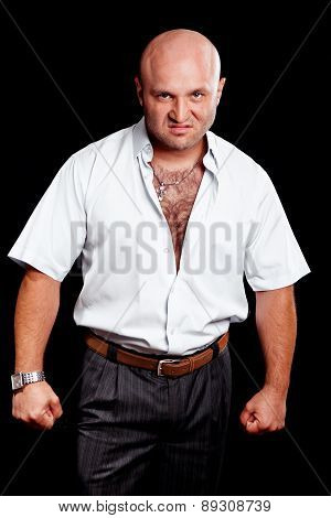 Aggressive Man On A Black Background