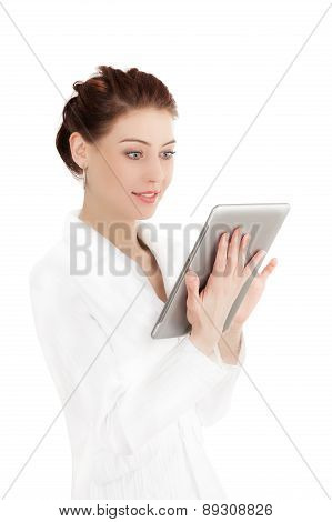 Young Woman Looking At A Tablet.
