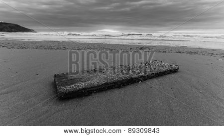 A Piece Of Wood Left Over At A Lonely Beach