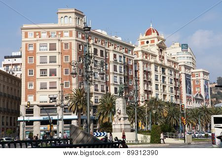 MALAGA, SPAIN - MAR 14 2015 : The city takes it easy on the avenida near Larios Square.