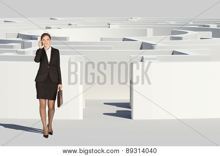 Businesswoman with suitcase going out labyrinth