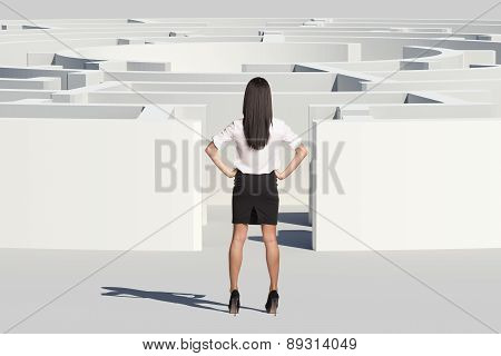 Businesswoman standing near labyrinth entrance