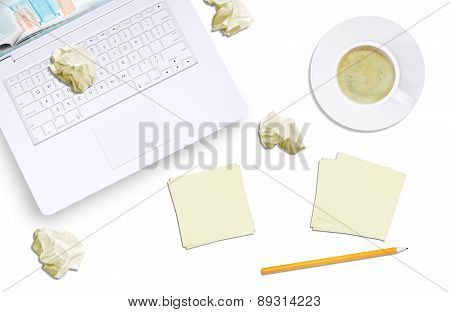 White laptop and crumpled piece of paper, top view