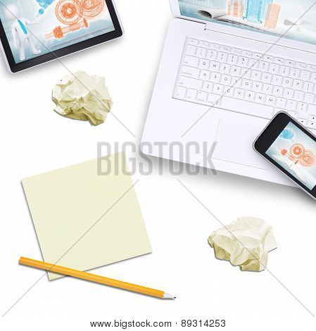 Phone on laptop with tablet, note paper near