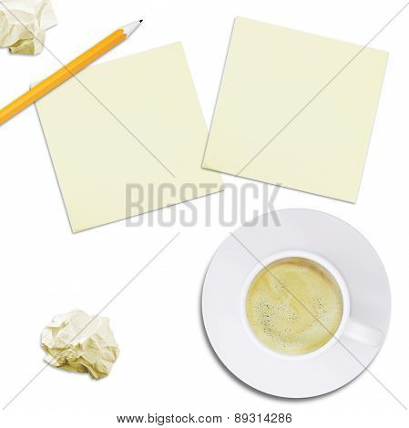 Cup with coffee and note paper, top view