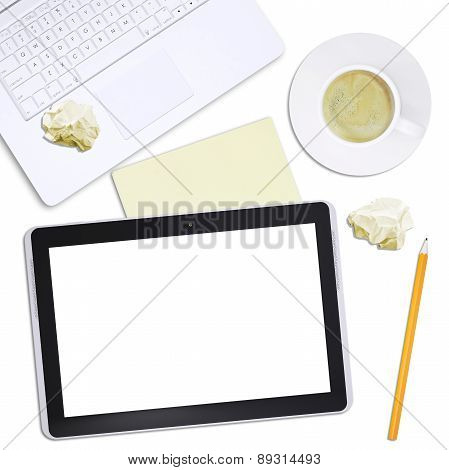 Black tablet with laptop and crumpled paper