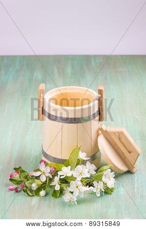 wooden tub, apple blossom, cherry blossom, mint, forget-me-not a turquoise background