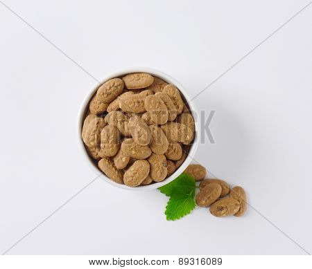 overhead view of bowl with chocolate cookies and mint